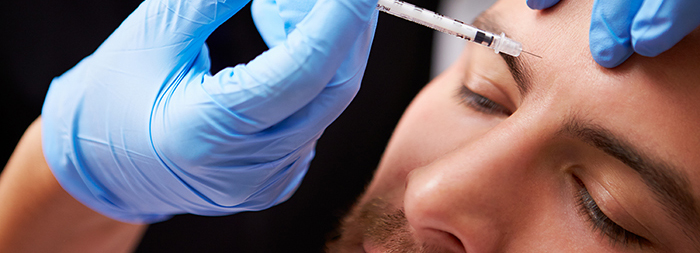 A man receives a Botox injection.